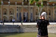 Bukhara, Uzbekistan, Silk Route. Bukhara, Uzbekistan, Tourist on the main square admiring ancient monuments of Bukhara of architectural pearl on the Silk Route stock photos