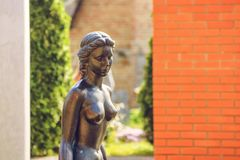 Naked iron statue of a girl close-up Royalty Free Stock Images