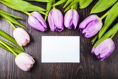 Bukiet tulipany i karta Fotografia Royalty Free