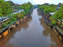 Bukit Timah canal. A big, wide monsoon canal between Dunearn Road and Bukit Timah road in Singapore. It is designed to carry away stormwater quickly to the sea Royalty Free Stock Photo