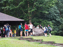 Bukit Timah Hill Nature Reserve, Singapore. Hikers resting at the summit of Bukit Timah hill Royalty Free Stock Image