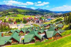 Bukovel, Carpathian Mountains, Ukraine. Scenic summer view of winter ski resort with house and cottage in Bukovel, Carpathian Mountains, Ukraine stock photo