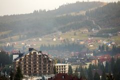 Bukovel ski resort village in Carpathian mountains ecological area. Comfortable modern hotels, residential houses, cottage under. Construction on green mountain royalty free stock images