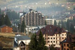Bukovel ski resort village in Carpathian mountains ecological area. Comfortable modern hotels, residential houses, cottage under. Construction on green mountain stock image