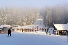 Skiers and snowboarders in line for the chairlift Stock Photography