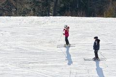 BUKOVEL, UKRAINE- 27 JANUARY 2018: Two people skiing on a ski tr royalty free stock photo