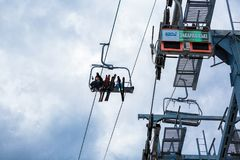 BUKOVEL, UKRAINE, March 06, 2017: skiers and snowboarders  lifting on ski-lift Royalty Free Stock Photography
