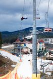 BUKOVEL, UKRAINE, March 06, 2017: skiers and snowboarders  lifting on ski-lift Stock Photo