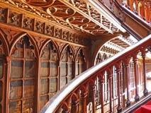 Buktig trappuppgång i en bokhandel, Porto, Portugal Arkivbilder