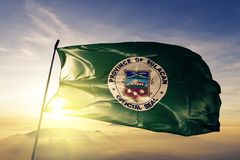 Bulacan province of Philippines flag textile cloth fabric waving on the top sunrise mist fog. Beautiful stock photography
