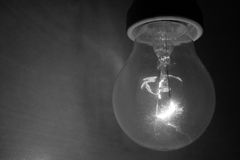 Bulb. Shining light in the darkness Royalty Free Stock Photo