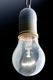 Bulb. Close up of a bright tungsten filament bulb Stock Image