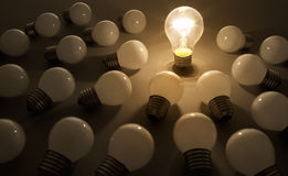 Bulb 2. One lit bulb shines on others, leader Royalty Free Stock Photo