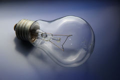 Bulb. The bulb lies on a dark blue background Royalty Free Stock Photography