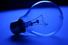 Bulb. In blue stock photo