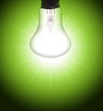 Bulb. Lighting bulb on green background with rays Stock Photo