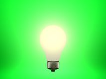 Bulb. Glowing lightbulb against a green background Stock Photography