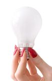 Bulb and beautiful woman hand.  Stock Photo