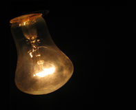Bulb on black background royalty free stock images