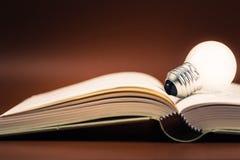 Bulb on Book Stock Photo