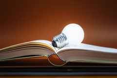 Bulb on Book Royalty Free Stock Image