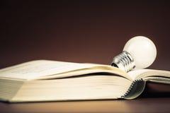 Bulb on Book Stock Photos