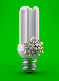 Bulb with a bow gift Royalty Free Stock Photography