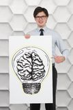 Bulb with brain. Businessman holding paper with drawing bulb with brain Stock Photos