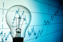Bulb with business background Stock Photo
