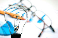 Bulb with business background Royalty Free Stock Photo