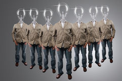 Bulb businessman Group in studio Royalty Free Stock Photography