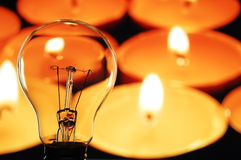 Bulb and candle Stock Photography