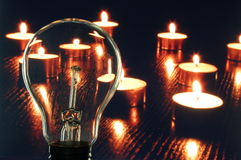 Bulb and candle Stock Photo