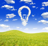 Bulb from clouds. In spring landscape Royalty Free Stock Photo