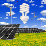 Bulb from clouds. Above the solar energy panels with wind turbines Royalty Free Stock Images