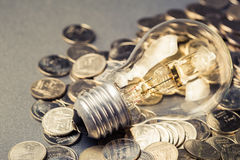 Bulb and Coins Royalty Free Stock Photography