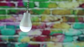 Bulb on a color background stock video