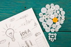 Bulb composed of the gears and sketches of graphs. Idea concept - bulb composed of the gears and sketches of graphs royalty free stock images