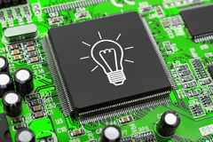 Bulb on computer chip Stock Photos