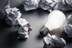 Bulb and Crumpled paper Stock Photos