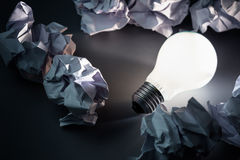 Bulb and Crumpled paper Royalty Free Stock Photos