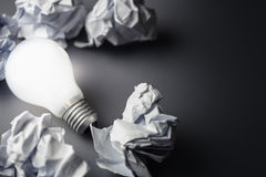 Bulb and Crumpled paper Stock Photo