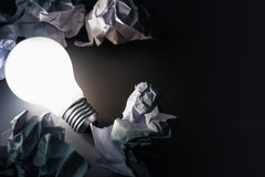 Bulb and Crumpled paper Royalty Free Stock Photo