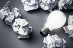 Bulb and Crumpled paper Stock Photography