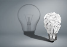 Bulb with crumpled paper and shadow, Idea creative concept Royalty Free Stock Photography