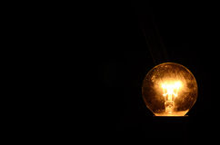 Bulb in darkness Stock Photography