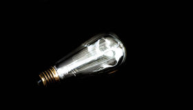 Bulb in darkness Royalty Free Stock Image