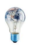 Bulb. Energy saving bulb with planet earth Stock Photography