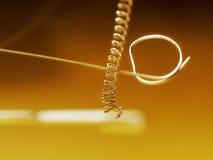 Bulb filament. A broken filament in a bulb Royalty Free Stock Images