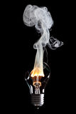 Bulb and fire Stock Image